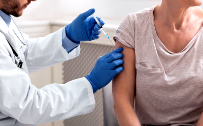 Improving vaccination rates by dispelling mistrust and conspiracy